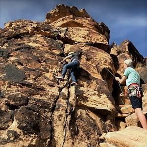 TFL mentor Cam taking students rock climbing.